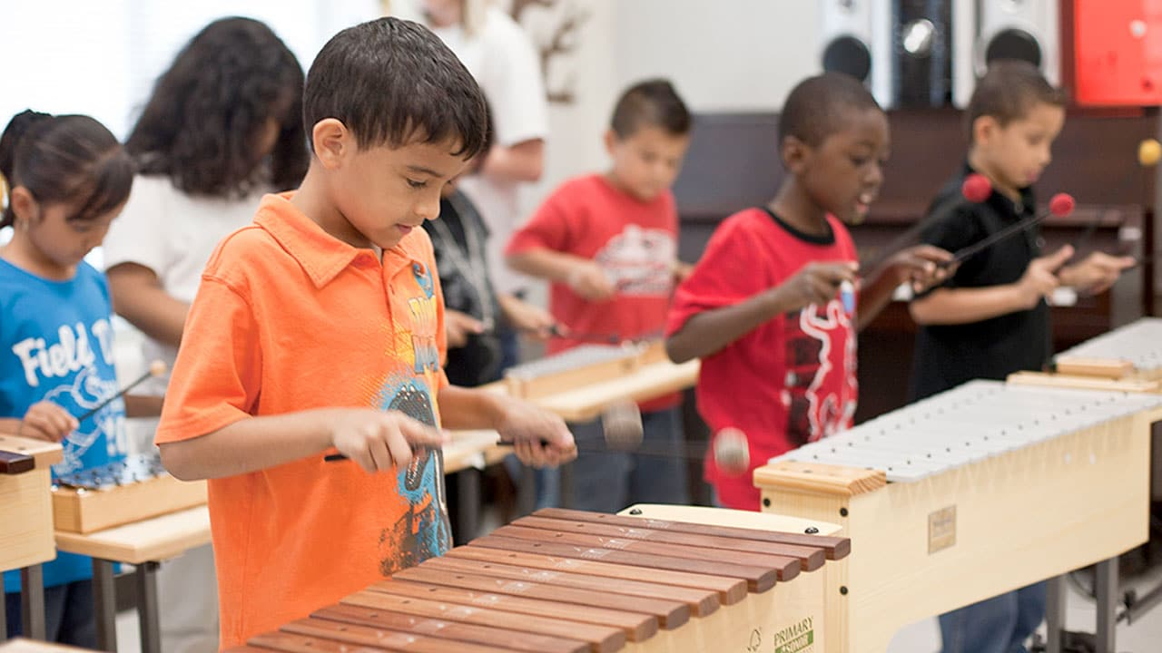 boy playing xylophone